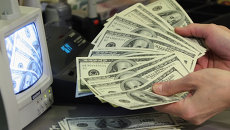 Средневзвешенный курс доллара на ЕТС на 11.30 снизился до 32,82 руб