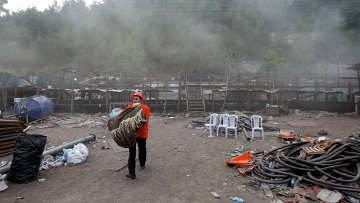 На месте обрушения шахты в населенном пункте Сома, Турция