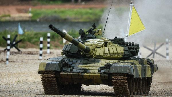 Экипаж танка войск Восточного военного округа во время соревнований Танковый биатлон-2014. Архивное фото