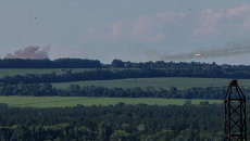Украинские военные ведут огонь из установки залпового огня Град, архивное фото