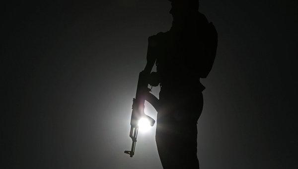 Полицейский с оружием. Афганистан