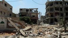 Разрушенные дома в городе Млейха. Архивное фото