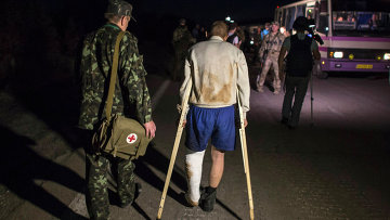 Украинский военный во время обмена пленными
