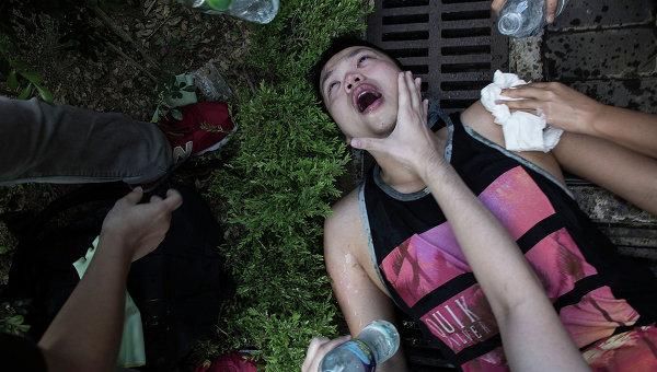 Раненый в результате столкновений полиции и протестующих в Гонконге