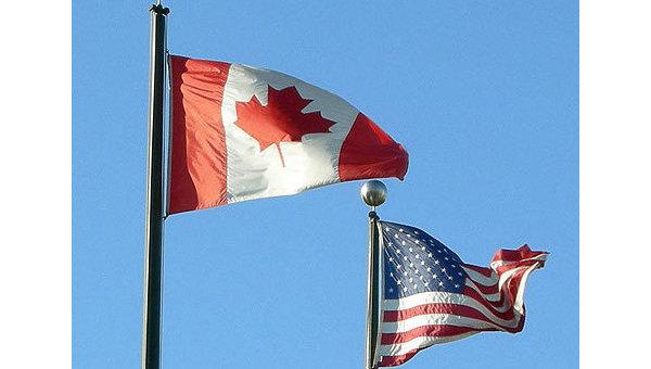 Флаги Канады и США. Архивное фото