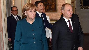 Ангела Меркель и Владимир Путин во время рабочего завтрака в Милане 17 октября 2014
