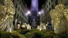 Церемония зажжения главной рождественской елки Нью-Йорка, установленной возле Рокфеллер-центра