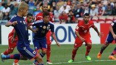Игроки сборных Японии и Палестины в матче на Кубок Азии