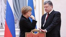 Канцлер Германии Ангела Меркель и президент Украины Петр Порошенко. Архивное фото