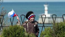 Участник праздничных мероприятий в Севастополе. Архивное фото.
