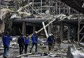 Наблюдатели ОБСЕ в разрушенном здании аэропорта Донецка