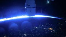 Корабль SpaceX Dragon, пристыкованный к модулю МКС. Архивное фото