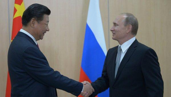 Президент Российской Федерации Владимир Путин и Председатель Китайской Народной Республики Си Цзиньпин во время встречи в Уфе