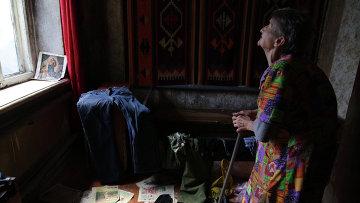 Раиса Алексеевна в своем доме, деревня Новомарьевка