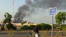 Гостиница Аль-Каср подвергшаяся обстрелу в городе Аден, Йемен