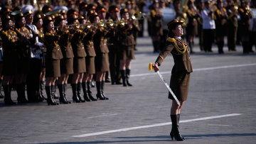 Участницы парада, посвященного 70-летию Трудовой партии Кореи, в Пхеньяне, КНДР
