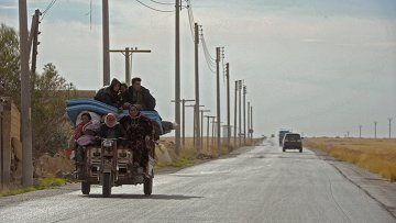 Дорога в пригороде сирийского города Алеппо