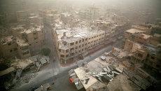Вид на разрушенные здания в городе Дума, Дамаск. Архивное фото