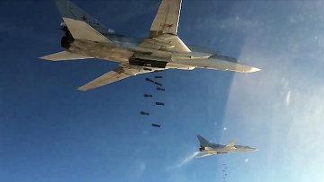 Бомбардировщики-ракетоносцы Ту-22 МЗ Военно-космических сил России во время нанесения авиаудара по объектам ИГ в Сирии. Архив