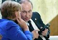 Президент России Владимир Путин и канцлер Германии Ангела Меркель на климатической конференции ООН в Париже