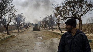 Военнослужащие Сирийской арабской армии на территории взятого под контроль военного аэродрома Мардж аль-Султан на юго-востоке Дамаска. 2015 год. Архивное фото