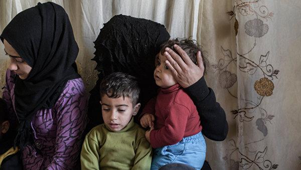 Беженцы в районе Ярмук в Дамаске