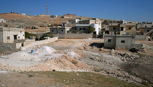 Здания в селе в южном пригороде сирийского города Алеппо. Архивное фото