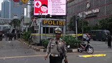 Джакарта после терактов: военные патрули и работа полиции на местах взрывов