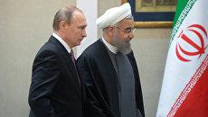 Президент России Владимир Путин и президент Исламской Республики Иран Хасан Роухани. Архивное фото