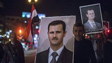 Плакат с изображением президента Сирии Башара Асада на одной из улиц Дамаска. Архивное фото
