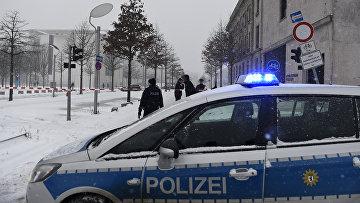 Полицейская машина на улице в Берлине, Германия. Январь 2016. Архивное фото