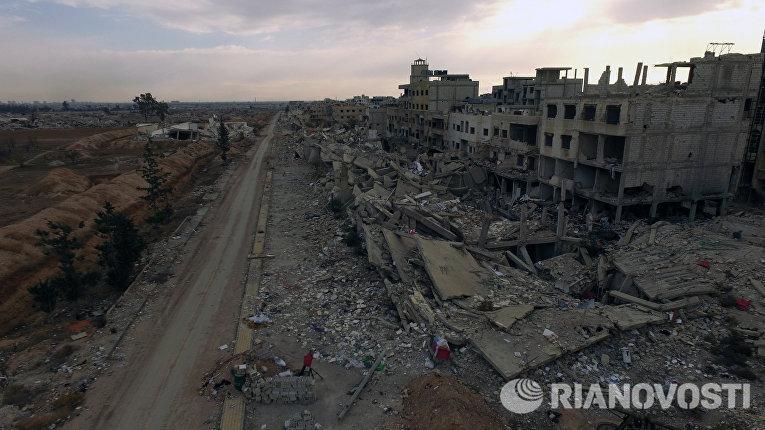 Пригород Дамаска Дарайа, где бойцами Сирийской арабской армии ведутся боевые действия против отрядов террористов
