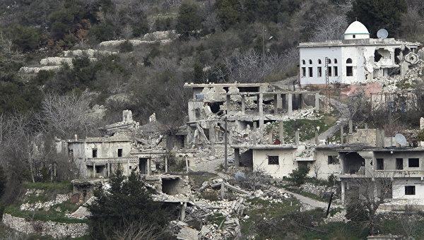 Разрушенные здания в городе Рабия. Январь 2016. Архивное фото