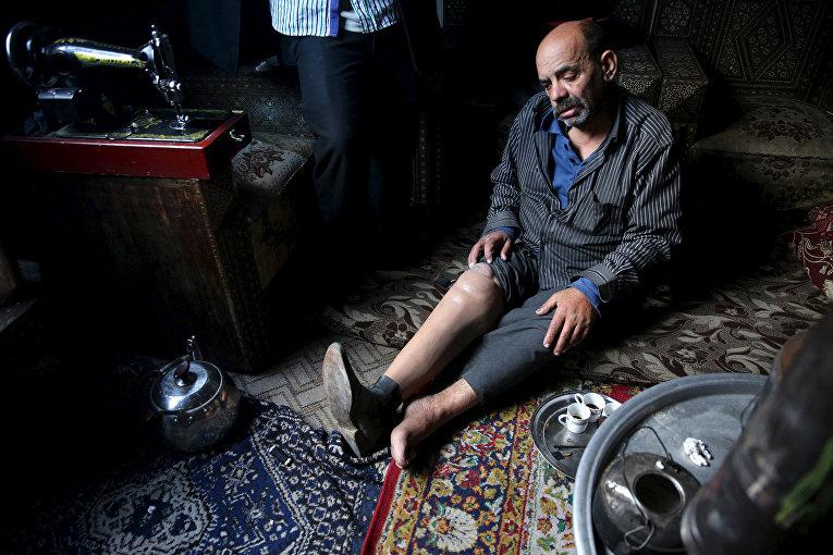 Инвалид Шахрур у себя дома, Ирбин, Сирия