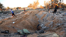 Последствия авиаударов США по позиция ИГ в Ливии. Архивное фото