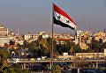 Флаг Сирии на улице Дамаска