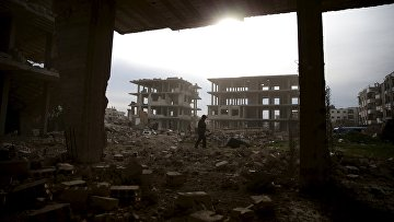 Разрушенные здания в пригороде Дамаска, Сирия. Март 2016