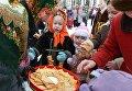 """Участники открытия Масленичной недели на территории музея деревянного зодчества """"Малые Корелы"""""""