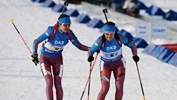 Дарья Виролайнен и Екатерина Юрлова на дистанции эстафеты среди женщин на чемпионате мира по биатлону в Холменколлене, 11 марта 2016