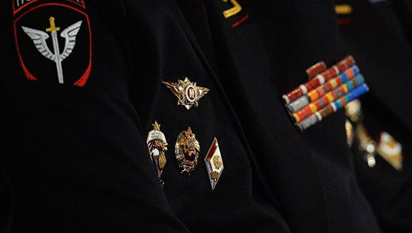 Знаки отличия на кителе сотрудника полиции, участвующего в расширенном заседании коллегии министерства внутренних дел РФ