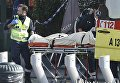 Пострадавший во время перестрелки спецназа с подозреваемыми террористами в коммуне Форе в Брюсселе. 15 марта 2016