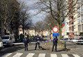 Сотрудники полиции Бельгии во время спецоперации в Скарбеке. 25 марта 2016