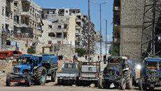 Местные жители продолжают жить в разрушенных домах в районе Салах-ад-дин в Алеппо