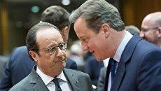Президент Франции Франсуа Олланд и премьер-министр Великобритании Дэвид Кэмерон во время саммита ЕС в Брюсселе