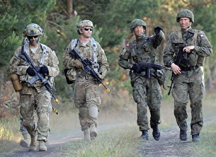 Солдаты польской армии и армии США во время учений НАТО Анаконда-2016 на территории Польши. 7 июня 2016