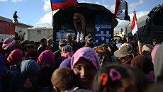Раздача российской гуманитарной помощи жителям Сирии. Архивное фото