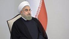 Президент Исламской Республики Иран Хасан Рухани во время встречи с президентом России Владимиром Путиным в Центре Гейдара Алиева в Баку. 8 августа 2016