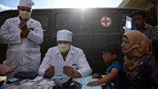 Российские врачи консультируют сирийских жителей. Архивное фото