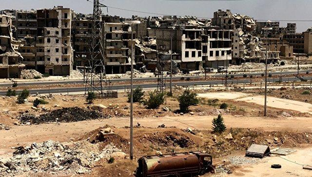 Разрушенные здания в районе Рамусе на юге города Алеппо в Сирии. Архивное фото