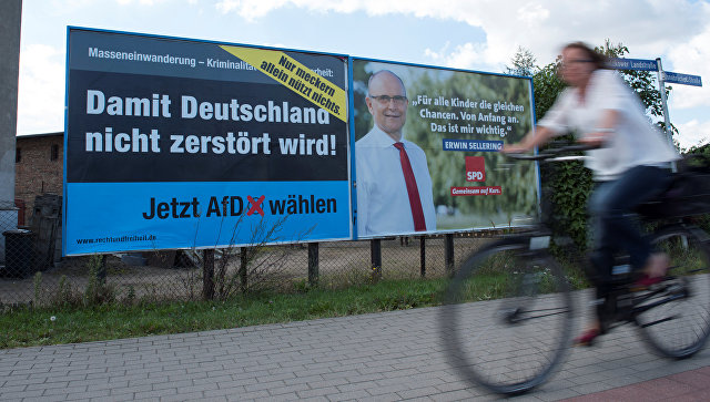 Агитационный плакат партии Альтернатива для Германии в Грифсвальде, земля Мекленбург-Передняя Померания, Германия. 30 августа 2016